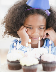 Mixed race girl at birthday party