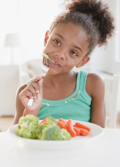 Mixed race girl eating healthy meal