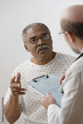 African man talking to doctor