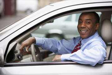 African businessman driving car