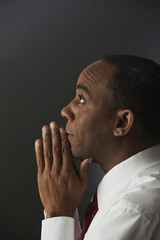 African businessman praying