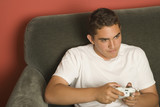 Hispanic teenager playing video game