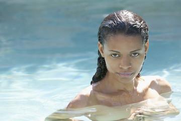 Nude mixed race woman in swimming pool