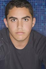 Serious Hispanic teenage boy