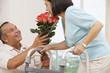 Hispanic man bring wife flowers