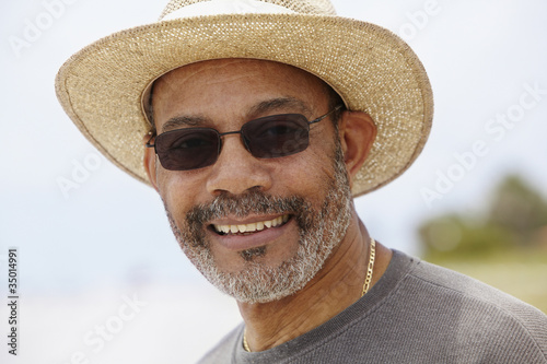 African man in straw hat smiling