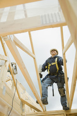 Hispanic construction worker building house