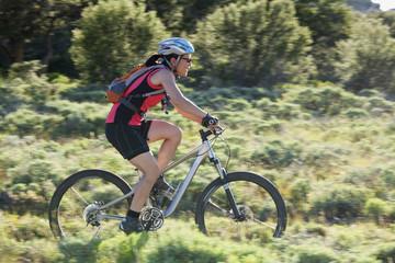 Japanese woman riding bicycle