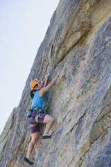 Japanese woman rock climbing