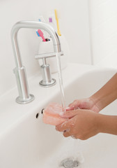 Hispanic girl washing hands