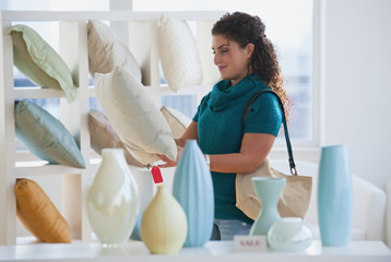 Mixed race woman shopping for pillows