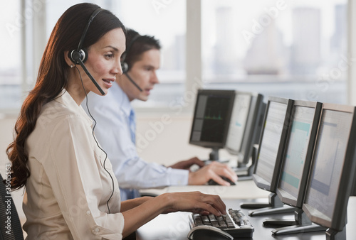 Hispanic businesswoman working on computer