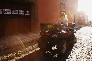 Hispanic woman riding recreational vehicle