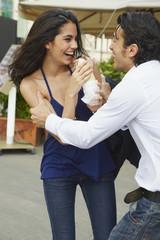 Boyfriend teasing girlfriend with sandwich