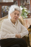 Senior Hispanic woman sitting in chair