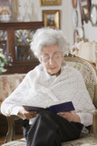 Senior Hispanic woman reading book