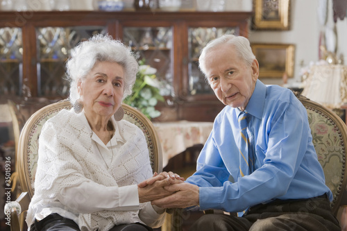 Senior Hispanic couple holding hands