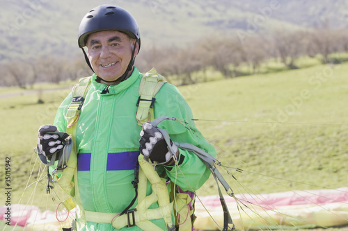 Senior Hispanic man skydiving