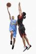 Mixed race women playing basketball