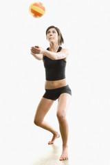 Hispanic woman playing volleyball