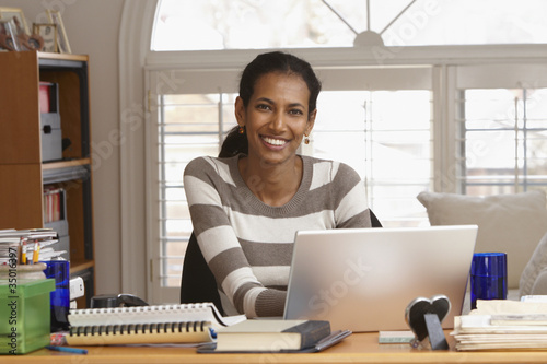 Black woman working in home office