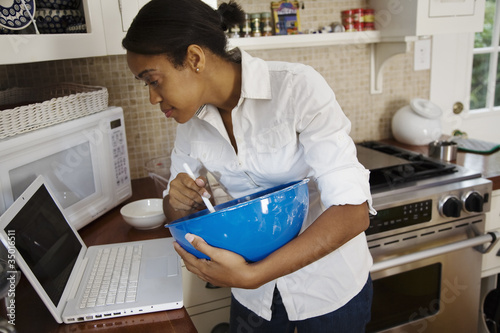 African woman following internet recipe