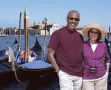 African American couple standing near gondolas