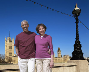African American couple on vacation at tourist attraction