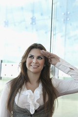 Hispanic businesswoman saluting