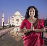 Indian woman in traditional clothing near the Taj Mahal