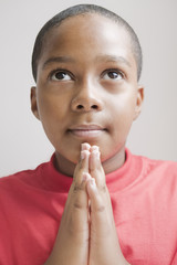 Hispanic boy praying