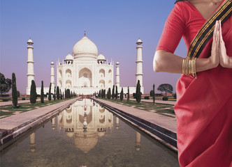 Indian woman in traditional clothing near the Taj Mahal