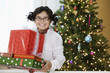 Mixed race girl holding Christmas gifts