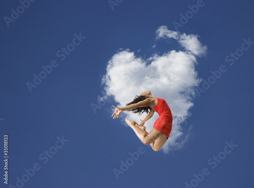 African American woman jumping in mid-air