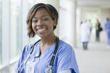 Black nurse in hospital hallway
