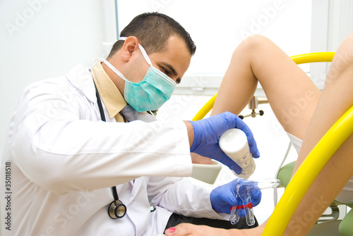 Doctor during a pelvic examination