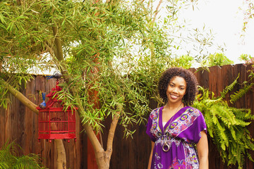African American woman standing in backyard