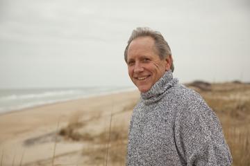 Caucasian man standing on beach