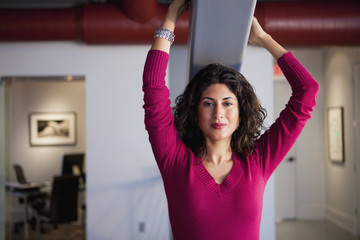 Ecuadorian woman holding onto beam