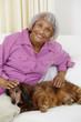Senior African American woman petting dog