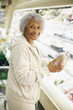 Senior African American woman shopping in grocery store
