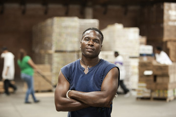 Black man standing in warehouse