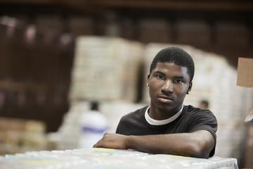 Black man standing in warehouse