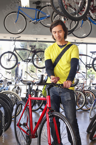 Mixed race customer choosing bicycle to buy