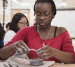 African American student working with clay in classroom