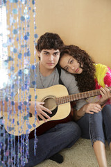 Boyfriend playing guitar for girlfriend