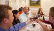 Friends toasting in restaurant