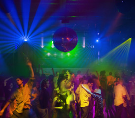 People dancing in nightclub