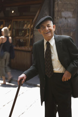 Senior Hispanic man with cane