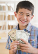Mixed race boy holding money